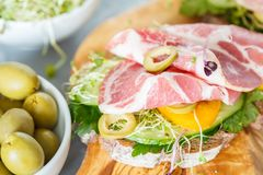 Sandwich with ham, olives, rye bread and vegetables Royalty Free Stock Photography