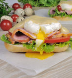 Sandwich with ham and poached egg Royalty Free Stock Photos