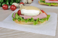 Sandwich with ham and poached egg Royalty Free Stock Photography