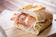 Sandwich with ham and salad on cutting board Royalty Free Stock Photography