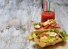 Sandwich with ham, salad, eggs and tomato Stock Photos