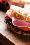 Sandwich with ham salad tomato on wood Royalty Free Stock Images