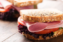 Sandwich with ham salad tomato on wooden background Royalty Free Stock Photo