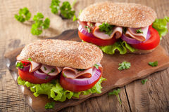 Sandwich with ham tomato and lettuce Royalty Free Stock Image