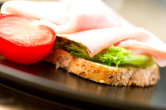 Sandwich ham tomato salad leaf Royalty Free Stock Images