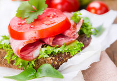 Sandwich with ham. Tomato and salad leaves Stock Image