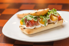 Sandwich with ham. Tomatoes and cheese on the bar Royalty Free Stock Photos