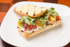 Sandwich with ham. Tomatoes and cheese on the bar Stock Images