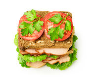 Sandwich with a ham and tomatoes. Isolated over white Stock Photography