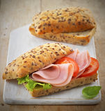 Sandwich with ham and tomatoes Royalty Free Stock Photos