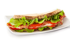 Sandwich with ham, tomatoes and salad Stock Photography
