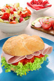 Sandwich with ham and tomatoes with vegetables salad Royalty Free Stock Photo