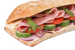 Sandwich with ham, vegetables and arugula salad  Royalty Free Stock Images