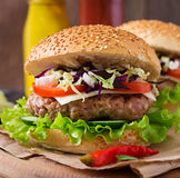 Sandwich hamburger with juicy burgers, cheese Royalty Free Stock Image