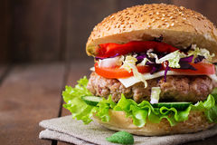 Sandwich hamburger with juicy burgers, cheese Royalty Free Stock Photo