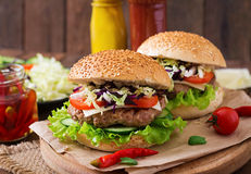 Sandwich hamburger with juicy burgers, cheese Royalty Free Stock Photo