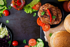 Sandwich hamburger with juicy burgers, cheese and mix of cabbage. Stock Photo
