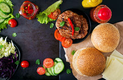 Sandwich hamburger with juicy burgers, cheese and mix of cabbage. Royalty Free Stock Image