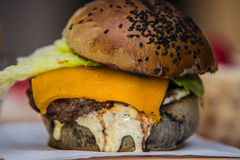 Sandwich hamburger with juicy burgers cheese and mix of vegetables Royalty Free Stock Image