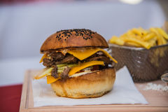 Sandwich hamburger with juicy burgers cheese and mix of vegetables Stock Photo