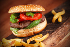 Sandwich with hamburger and tomato Royalty Free Stock Photo
