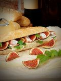 Sandwich with hamon, figs, arugula and Parmesan cheese Royalty Free Stock Photos