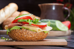 Sandwich. Healthy sandwich with cucumber, lettuce and tomato Stock Image