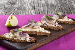 Sandwich with herring fillets, onion, pickled cucumber and dill Royalty Free Stock Photography