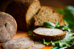 A sandwich with homemade sausage and rye bread Stock Photos