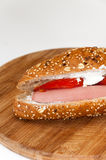 Sandwich with hot dog tomato white cheese cereals Stock Photos