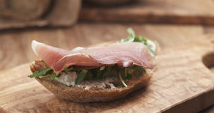 Sandwich with italian speck, arugula and cream cheese Stock Images