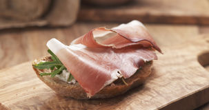 Sandwich with italian speck, arugula and cream cheese Royalty Free Stock Image