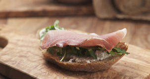 Sandwich with italian speck, arugula and cream cheese Royalty Free Stock Photography