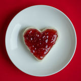 Sandwich with jam. Small sandwich with heart shaped raspberry jam stock photography