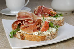 Sandwich of jamon with ricotta, arugula and cheese Royalty Free Stock Images