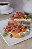 Sandwich of jamon with ricotta, arugula and cheese Stock Photography