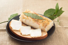 Sandwich with lard and laurel leaf. On a black plate Royalty Free Stock Photo