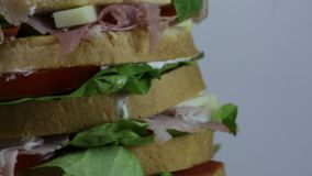 Sandwich with lettuce tomato cheese salami ham stock video footage
