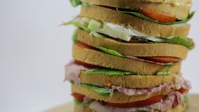 Sandwich with lettuce tomato cheese salami ham stock video