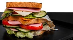 Sandwich lokalisiert auf Schwarzweiss-Hintergrund Stockbild
