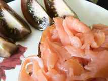Sandwich with lox. Sandwich with smoked salmon and tomatoes on the side royalty free stock photos