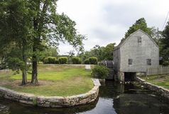 Sandwich, MA, Dexter Grist Mill. Lovely wooden Dexter`s Grist Mill and Water Wheel built in 1637 is still in use in the Cape Cod village of Sandwich Stock Images