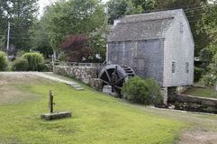 Sandwich, MA, Dexter Grist Mill. Lovely wooden Dexter`s Grist Mill and Water Wheel built in 1637 is still in use in the Cape Cod village of Sandwich Stock Image