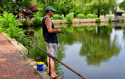 Sandwich, MA: Man Fishing in Grist Mill Pond Stock Images