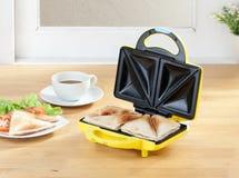 Sandwich maker machine in the kitchen