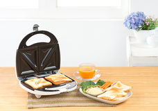 Sandwich maker machine isolated   Stock Photos