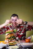 Sandwich: Man Wearing Onion Ring Glasses Royalty Free Stock Photos