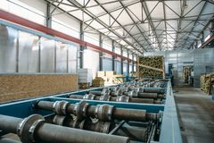 Sandwich manufactory panel production line. Equipment machine tools and roller conveyor in large hangar or workshop. Interior stock images