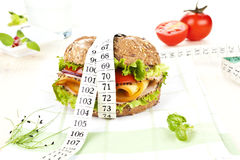 Sandwich with measuring tape. Stock Photos