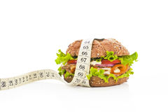 Sandwich with measuring tape. Fitness concept. Stock Photos